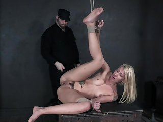 Blonde screams in scenes of rough BDSM maledom