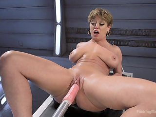 Short hair Dee Williams penetrated in both holes with a fuck machine