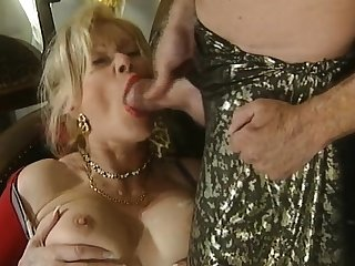 Splendid blowjob from the mature busty blonde