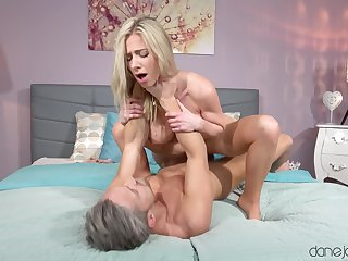 Fake-chested blonde gets licked before taking cock for a ride